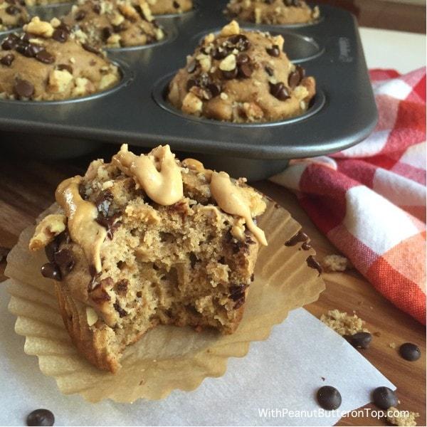 Chocolate Chip Banana Yogurt Muffins -These muffins are moist and soft and have the perfect amount of sweetness to satisfy your cravings - and without the guilt.Under 200 calories! #muffins #chocolate #healthy #dessert | www.withpeanutbutterontop.com