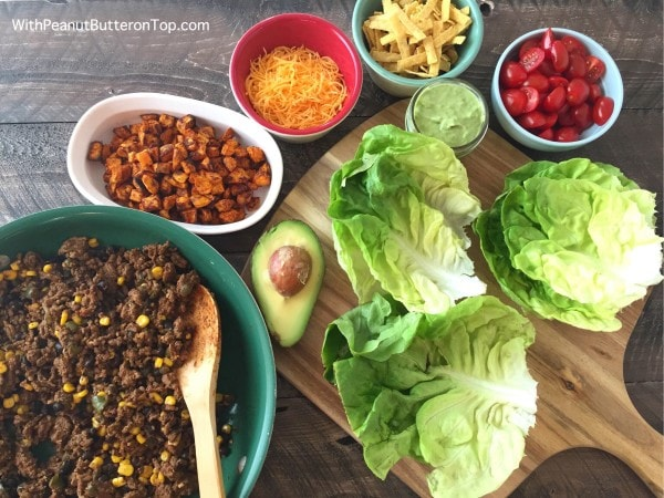 Southwest Style Sweet Potato Taco Lettuce Wraps - a wonderful lower-carb, diet friendly recipe, packed full of flavor and spice-  without the guilt. And only 177 calories per wrap! #salad #wraps #tacowraps #lettucewraps #healthy #lowcarb | https://withpeanutbutterontop.com
