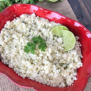 Garlic and Lime Cauliflower Rice - a delicious low-carb alternative to regular rice. This is a simple and easy-to-make side dish that uses fresh, healthy ingredients. I promise that you won't miss the rice too much! It is also great if you're looking for a comforting carb-filled meal, but without the hefty carb load! #cauliflower #cauliflowerrice #vegetables #sidedish #mexican #healthy | www.withpeanutbutterontop.com