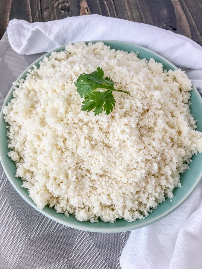 How To Make and Freeze Cauliflower Rice - this is the perfect healthy, low-carb alternative to rice, quinoa, or pasta. Being that it contains only one ingredient, it is perfect foralmost any meal plan and is also easier to make than you think! All you need is a knife with a cutting board and a food processor. #cauliflower #cauliflowerrice #howto #diy #doityourself #sidedish #healthy