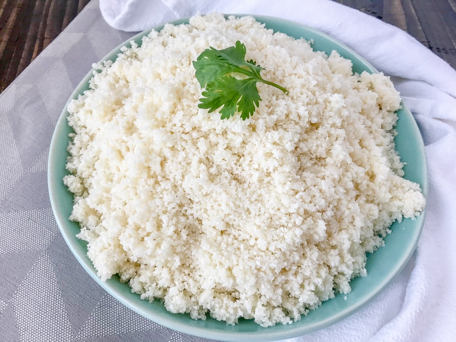 How To Make and Freeze Cauliflower Rice - this is the perfect healthy, low-carb alternative to rice, quinoa, or pasta. Being that it contains only one ingredient, it is perfect for almost any meal plan and is also easier to make than you think! All you need is a knife with a cutting board and a food processor. #healthy #sidedish #cauliflower #cauliflowerrice #diy #doityourself | www.withpeanutbutterontop.com