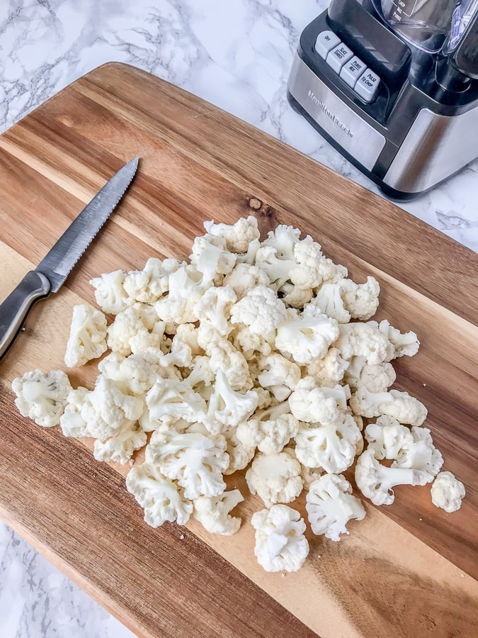 How To Make and Freeze Cauliflower Rice - this is the perfect healthy, low-carb alternative to rice, quinoa, or pasta. Being that it contains only one ingredient, it is perfect foralmost any meal plan and is also easier to make than you think! All you need is a knife with a cutting board and a food processor. #healthy #sidedish #cauliflower #cauliflowerrice #diy #doityourself | www.withpeanutbutterontop.com