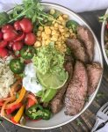 Steak Fajitas Bowls with Garlic Lime Cauliflower RIce Bowls | www.withpeanutbutterontop.com