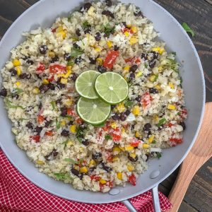 Cilantro Lime Black Bean and Corn Cauliflower Rice - an incredibly easy and flavorful side dish that is packed full of veggies and can be on your plate in 15 minutes or less! 115 calories per serving! #healthy #cauliflowerrice #glutenfree #vegan #healthy | https://withpeanutbutterontop.com