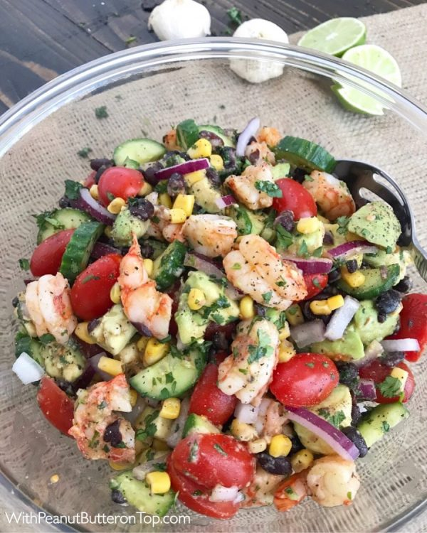 Cilantro Lime Shrimp and Avocado Salad - a salad packed full of vegetables that will become a go-to meal or dish in your kitchen from the moment you try it! This salad is very easy to make, light and refreshing in flavor, and can be made in minutes. The perfect low-calorie meal or side dish if you're looking for something simple and quick. #salad #shrimp #avocado #healthy | https://withpeanutbutterontop.com