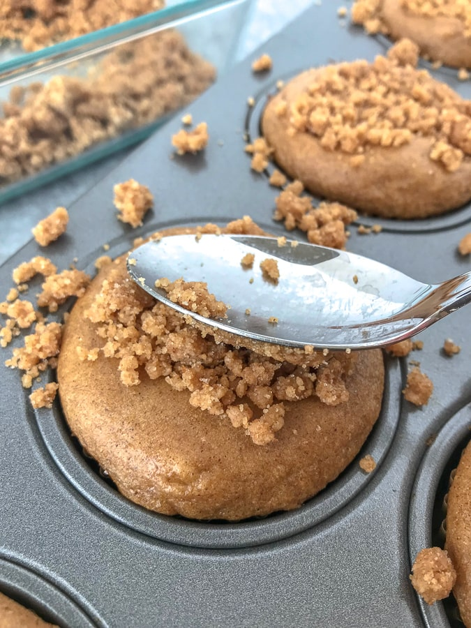 Greek Yogurt Banana Coffee Cake Muffins - the classic coffee cake that we all love transformed into muffin form - made a bit on the healthier side with greek yogurt and banana! Loaded with the perfect amount of cinnamon streusel crumb topping that offers the perfect texture contrast to the light and fluffy base. #muffins #coffeecake #breakfast #dessert   https://withpeanutbutterontop.com