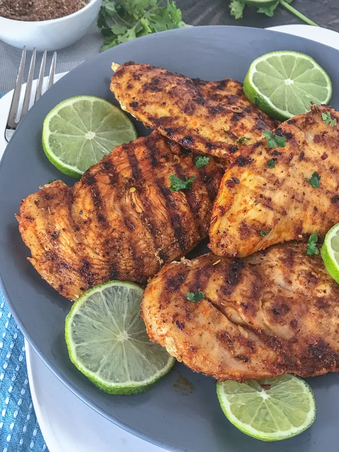 Grilled Cajun Lime Chicken - juicy, tender and flavorful chicken that is super easy to make and can be on your table in under 15 minutes! And can you really go wrong with a delicious slice of chicken that is under 200 calories?? #healthy #cajunseasoning #cajun #chickenbreast #grilledchicken #dinner | https://withpeanutbutterontop.com