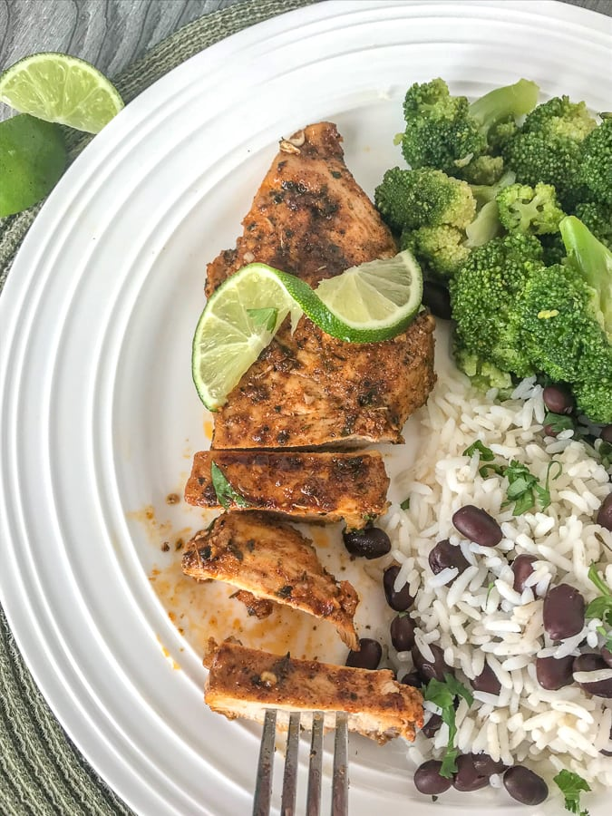 Easy Grilled Jamaican Jerk Chicken - this marinated jerk chicken is truly the most delicious summertime grilling recipe! It's a zesty-lime and spice flavor bomb from the very first bite! Easy to make, full of flavor, and perfect for meal prepping. #chicken #healthy #grilled | https://withpeanutbutterontop.com