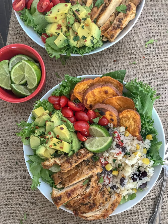 Jamaican Jerk Chicken Bowls - super simple and so much flavor packed into one bowl! These bowls have a hint of spice, but are packed full of healthy veggies and the perfect, healthy meal for any occasion! #healthy #chicken #bowls | https://withpeanutbutterontop.com