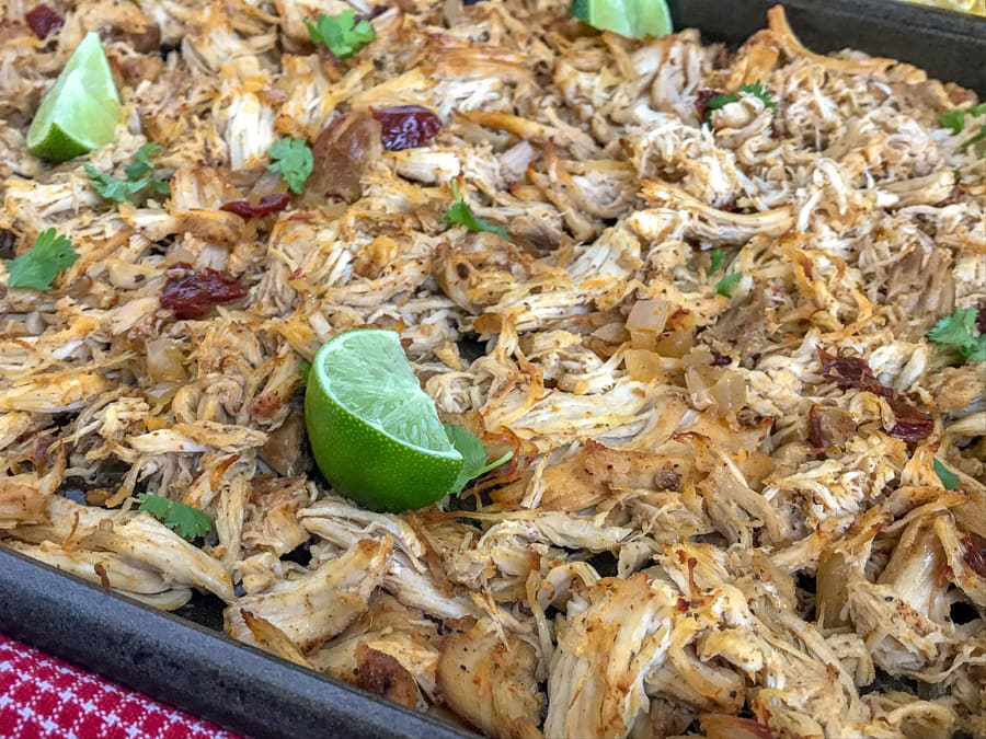 Easy Crockpot ChipotleChicken Carnitas - a healthier take on the traditional pork carnitas that we all know and absolutely adore! Perfect for on-the-go individuals, for parties, and an easy option for your weekly meal prep! #carnitas #slowcooker #crockpot #mexican #cincodemayo https://withpeanutbutterontop.com