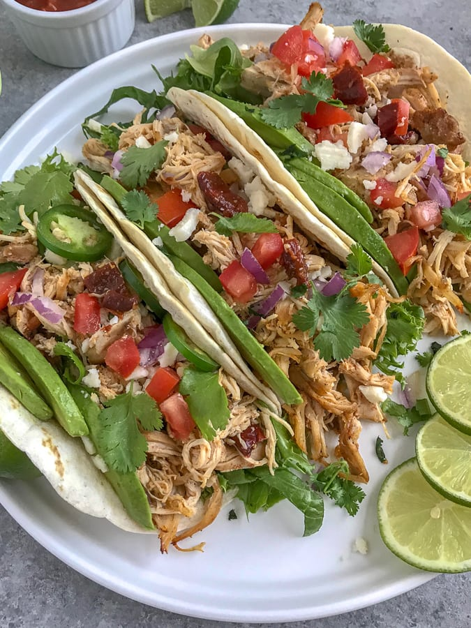 Easy Crockpot Chipotle Chicken Carnitas - a healthier take on the traditional pork carnitas that we all know and absolutely adore! Perfect for on-the-go individuals, for parties, and an easy option for your weekly meal prep! #carnitas #slowcooker #crockpot #mexican #cincodemayo https://withpeanutbutterontop.com