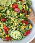 Cucumber Avocado Corn Salad - an easy to make, light and refreshing salad that is perfect as a side dish for any occasion! #salad #avocado #sidedishes #easy |https://withpeanutbutterontop.com