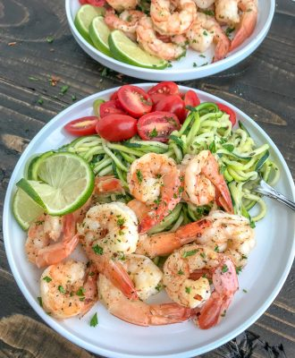 Garlic Honey Lime Shrimp and Zoodles -  the perfect low-carb, high-protein recipe that comes together in 15 minutes. Sweet, sticky, garlic lime cooked shrimp and zucchini noodles are the ultimate easy and healthy combination. #shrimp #zoodles #zucchininoodles #lowcarb #healthy | https://withpeanutbutterontop.com