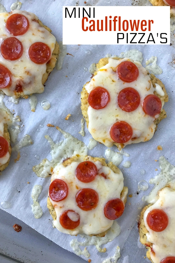 Mini Cauliflower Pepperoni Pizza's - the best, crispy cauliflower pizza you will ever try! Easy, healthier, and lower-carb! #cauliflowerpizza #cauliflower #lowcarb #healthy #pizza | https://withpeanutbutterontop.com