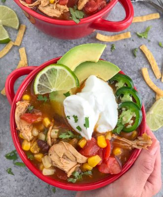 Easy Instant Pot Chicken Taco Soup - a delicious, healthy, and super easy meal to make that requires little effort and only one pot! Perfect for #mealprep and cold winter days! #tacosoup #instantpot #instantpotrecipes #tacotuesday #soup   https://withpeanutbutterontop.com