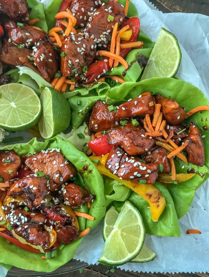 Honey Garlic Chicken Lettuce Wraps - low carb, sweet and savory, and full of flavor. #honeygarlicchicken #lowcarb #healthy #lettucewrap | https://withpeanutbutterontop.com