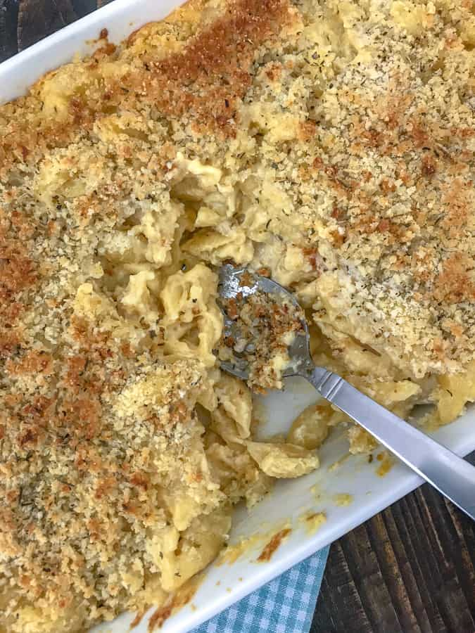 Baked Macaroni and Cheese - cheesy, creamy perfection! The ultimate macaroni and cheese dish that will make your taste buds sigh like a comfort dish should! #baked #macaroniandcheese #macandcheese #maindish |https://withpeanutbutterontop.com