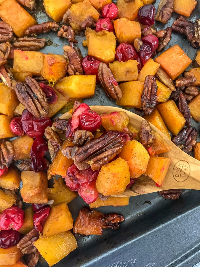 Honey Roasted Butternut Squash - a side dish that comes together so easily and with an abundance of flavor! Your taste buds will be tickled pink with this dish! Easy to make and perfect for the holiday season. #butternutsquash #thanksgiving #sidedish   https://withpeanutbutterontop.com