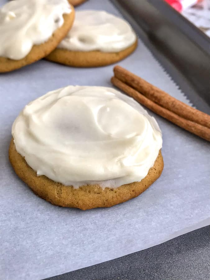 Pumpkin Cake Cookies with Homemade Cream Cheese Frosting - soft, fluffy, and tastes like mix between a cookie and cake! So delicious you will have a hard time just having one! #cookies #pumpkin #pumpkincookies #dessert   https://withpeanutbutterontop.com