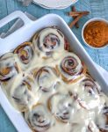 Pumpkin Cinnamon Rolls with Cream Cheese Frosting - a perfect, fall twist to a classic breakfast favorite! Fill your home and your tummies with this amazing, flavor-packed dessert! #pumpkin #cinnamonrolls #pumpkincinnamonrolls #breakfast #fall | https://withpeanutbutterontop.com