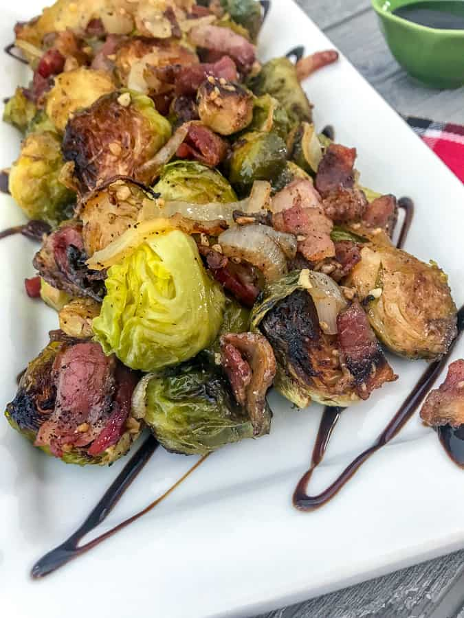 Roasted Balsamic Brussels Sprouts - an easy, fantastic side dish that is full of flavor - crispy, roasted brussels sprouts, savory and salty bacon, and a delicious tangy balsamic glaze! #brusselssprouts #sidedish #thanksgiving | https://withpeanutbutterontop.com