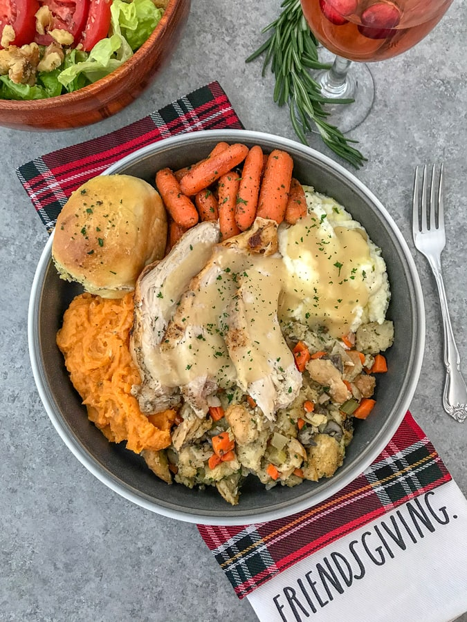 Friendsgiving Day Spread - a compilation of lightened up holiday dishes perfect for your next Friendsgiving get together, for a small family, or if you're simply looking to keep your holiday indulgences on the lighter side this holiday season! Rolls, Instant Pot Turkey, Mashed Cauliflower, Mashed Sweet Potatoes, Maple Roasted Carrots, and Traditional Herb Stuffing! #Thanksgiving #Friendsgiving #holidayrecipes #thanksgivingrecipes | https://withpeanutbutterontop.com