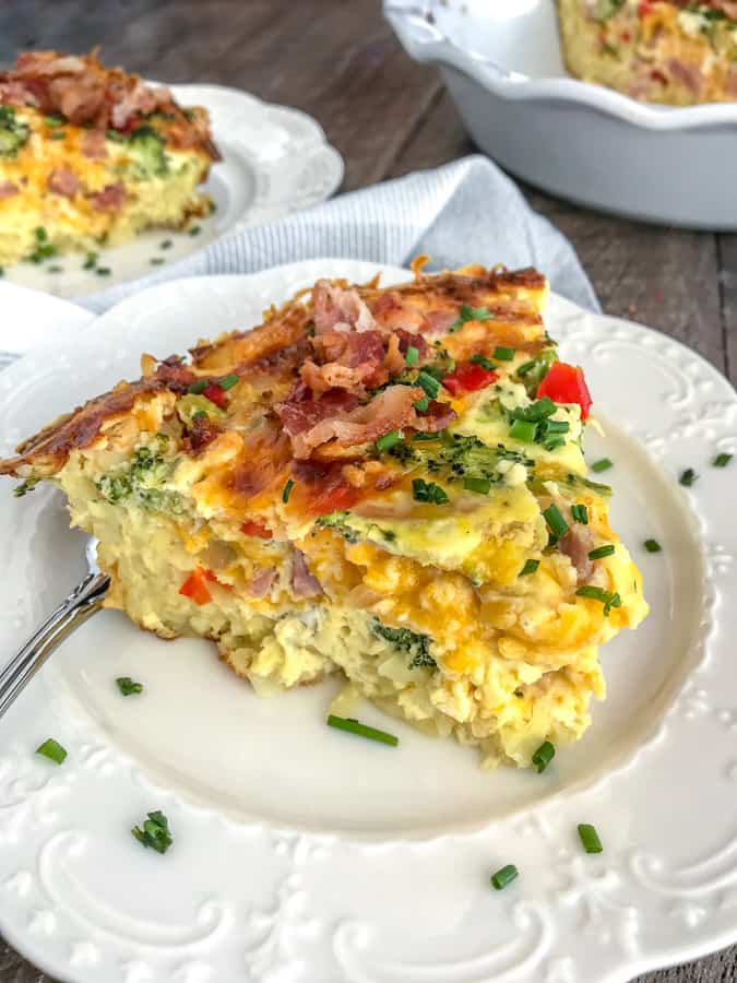 Ham and Broccoli Hash Brown Quiche - the perfect use for leftover holiday ham! Easy to make, full of vegetables and flavor, and guaranteed to wow your family and guests! Hash browns replace the traditional crust in a delicious way. #breakfast #ham #leftovers #quiche | https://withpeanutbutterontop.com