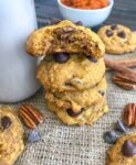 Chocolate Chip Pumpkin Pecan Cookies - soft, moist cookies with the perfect hint of pumpkin flavor, while being loaded with oats, chocolate chips, and pecans! Great for after school or on-the-go snacks! #cookies #pumpkincookies #pumpkin #chocolatechip | https://withpeanutbutterontop.com