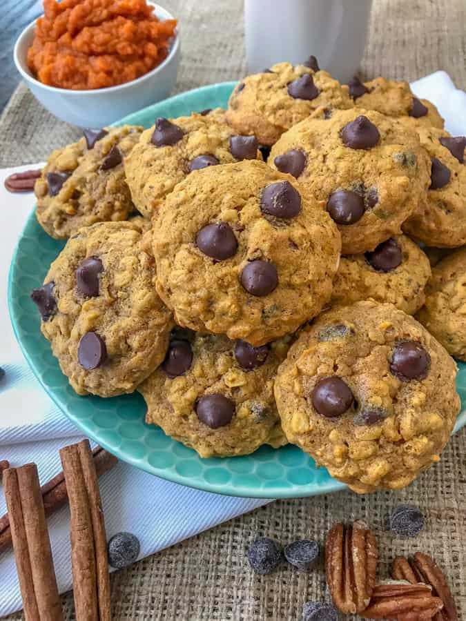 Chocolate Chip Pumpkin Pecan Cookies - soft, moist cookies with the perfect hint of pumpkin flavor, while being loaded with oats, chocolate chips, and pecans! Great for after school or on-the-go snacks! #cookies #pumpkincookies #pumpkin #chocolatechip   https://withpeanutbutterontop.com