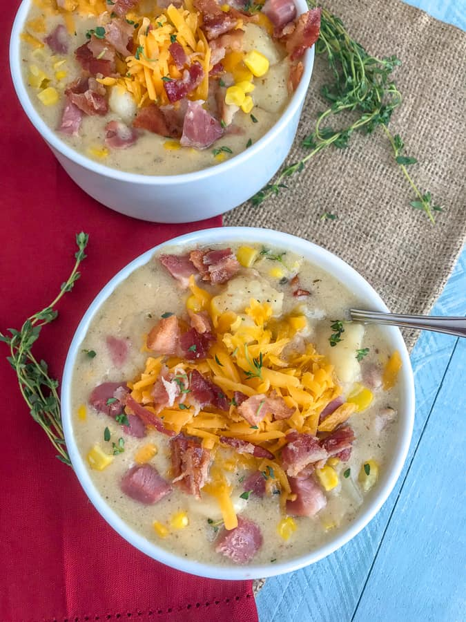 Instant Pot Ham Potato and Corn Chowder - an easy-to-make, one pot soup that uses leftover ham bone and ham from the holidays! Full of sweet corn, potatoes, and salty chunks of ham. Sure to be a crowd pleaser at your dinner table! #soup #hambone #ham #chowder #onepot   https://withpeanutbutterontop.com
