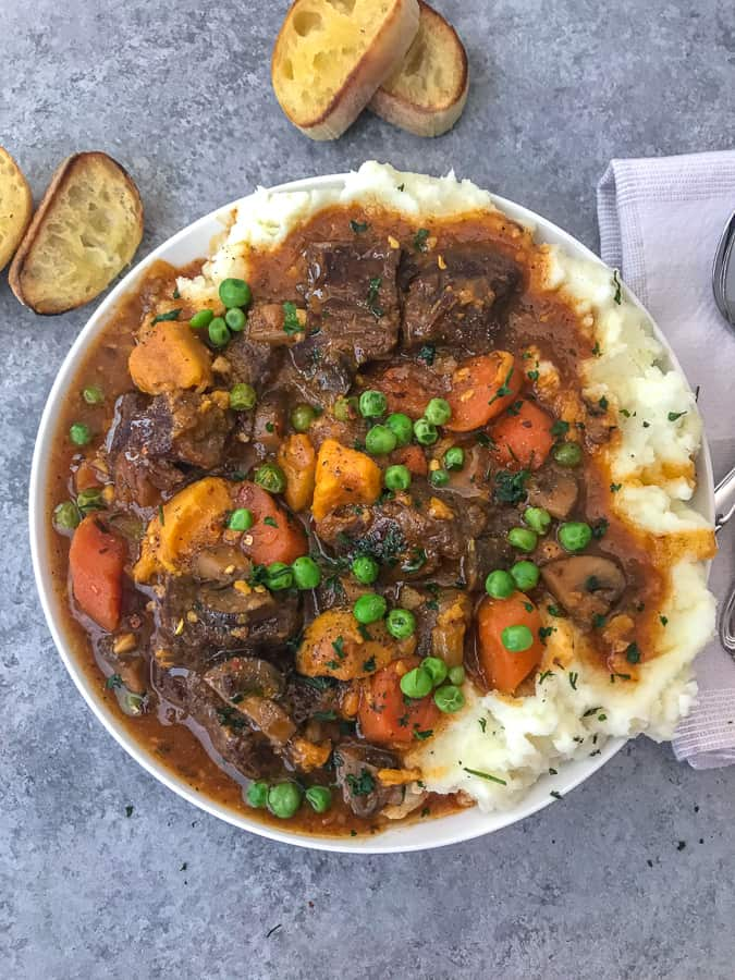 Instant Pot Sweet Potato Beef Stew - Learn how to make the BEST beef stew in the Instant Pot in approximately 1 hour! Full of flavor, vegetables, sweet potatoes and the most tender beef! #beefstew #instantpot #instantpotbeefstew | https://withpeanutbutterontop.com