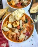 One Pot Sausage Tortellini Tomato Soup - a super delicious and easy recipe that is filled with turkey sausage, cheese tortellini, kale, and herbs in a delicious tomato base! Hearty, filling, and yummy! #soup #healthysoup #sausagetortellinisoup   https://withpeanutbutterontop.com