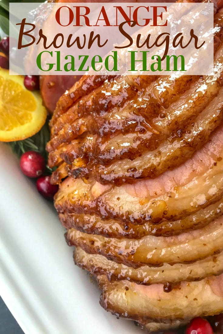 Orange Brown Sugar Glazed Ham - the perfect juicy main course for your holiday table! So easy to make, fully of flavor, and guaranteed to be a hit with your friends and family! #ham #orangeglazedham #christmas #dinner | https://withpeanutbutterontop.com
