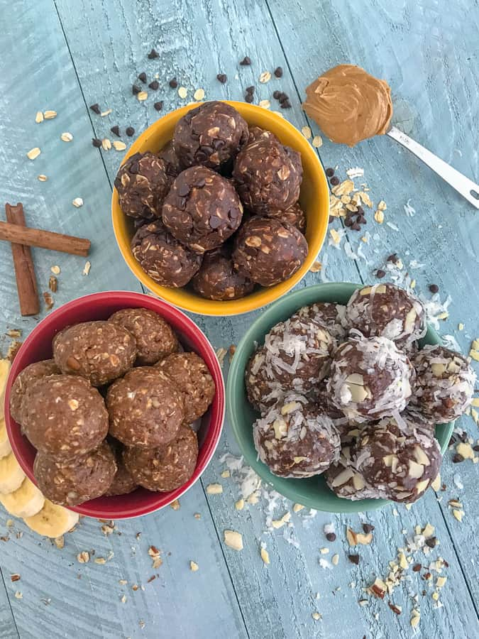 Got a sweet tooth craving that you can't kick? Need a healthy alternative to do so? Then try these No-Bake Oatmeal Energy Bites! Three delicious flavors to choose from that are easy and kid-friendly! #mealprep #proteinbites #energybites #oatmeal #nobake   https://withpeanutbutterontop.com