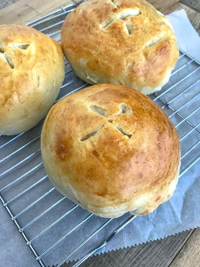 Learn how to make Bread Bowls at home with this simple recipe, containing only 6 ingredients! Golden and crispy on the outside while being soft and fluffy on the inside! Perfect for soups, stews, and dips! #homemadebread #breadbowls #soupbowls #soup | https://withpeanutbutterontop.com