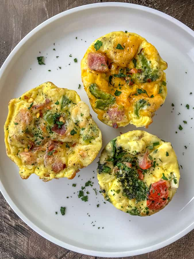 Make Ahead Egg Muffins - Done 3 Ways!! Perfect, quick and simple recipe for meal prepping, as a post-workout meal, or for busy lifestyles! High in protein, low in carbs - making these Keto-friendly! #eggmuffins #mealprep #breakfastmealprep #breakfast #easyrecipes   https://withpeanutbutterontop.com