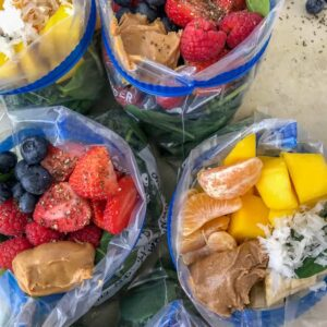 Make Ahead Freezer Smoothie Packs - homemade smoothie packs that come together easily and quickly! Perfect for meal prepping. Enjoy the convenience of a grab-n-dump smoothie straight from your freezer! #smoothies #freezersmoothiepacks #smoothiepacks #mealprep #makeahead | https://withpeanutbutterontop.com