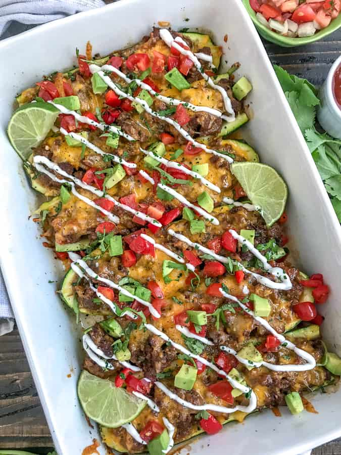 Taco Stuffed Zucchini Boats - a delicious, healthy and low-carb way to indulge in Taco Tuesday without the guilt. Filled with delicious taco flavors - I guarantee you won't miss the tortilla! #lowcarb #tacotuesday #zucchiniboats | https://withpeanutbutterontop.com