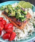 Super simple, quick and healthy recipe! Perfectly seasoned and pan seared salmon over a bed of cilantro lime rice and garnished with a creamy avocado salsa that is bursting full of flavor! #cajunsalmon #salmon #searedsalmon #salmonbowl   https://withpeanutbutterontop.com