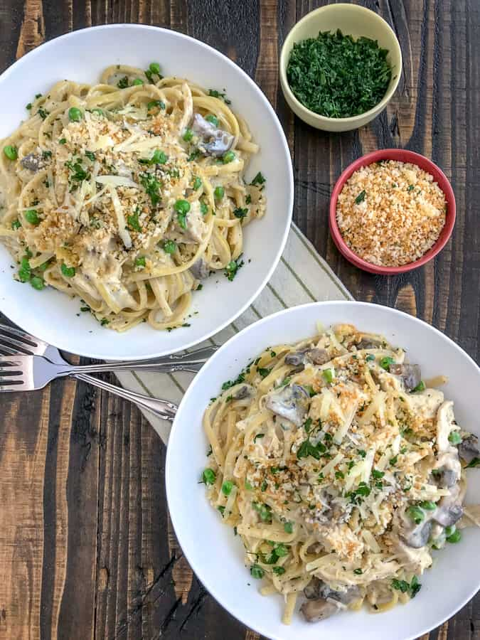 An easy and addicting comfort dish! All comes together in the Instant Pot and guaranteed to become a new family favorite! Chunks of chicken, beefy baby portobello mushrooms, and linguine - all in a creamy, parmesan cheese sauce. Truly addicting! #tetrazzini #chickentetrazzini #instantpot #pasta | https://withpeanutbutterontop.com