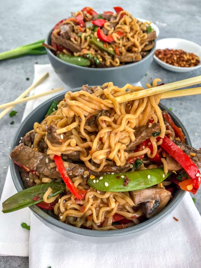 This Garlic Beef and Ramen Stir Fry is so easy to make, bursting full of flavor, and guaranteed to wow you and your dinner guests! A much healthier version of take-out that can be made right at home! #takeout #ramennoodles #garlicbeefandramen | https://withpeanutbutterontop.com