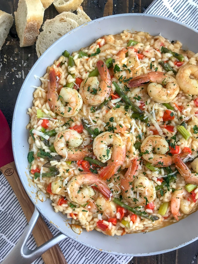 This Garlic Butter Shrimp with Asiago Risotto recipe is the perfect date night meal! Comes together in one pot, is bursting full of flavor and is so easy to make. I guarantee your taste buds will be floored! #risotto #garlicbuttershrimp #asiagorisotto | https://withpeanutbutterontop.com