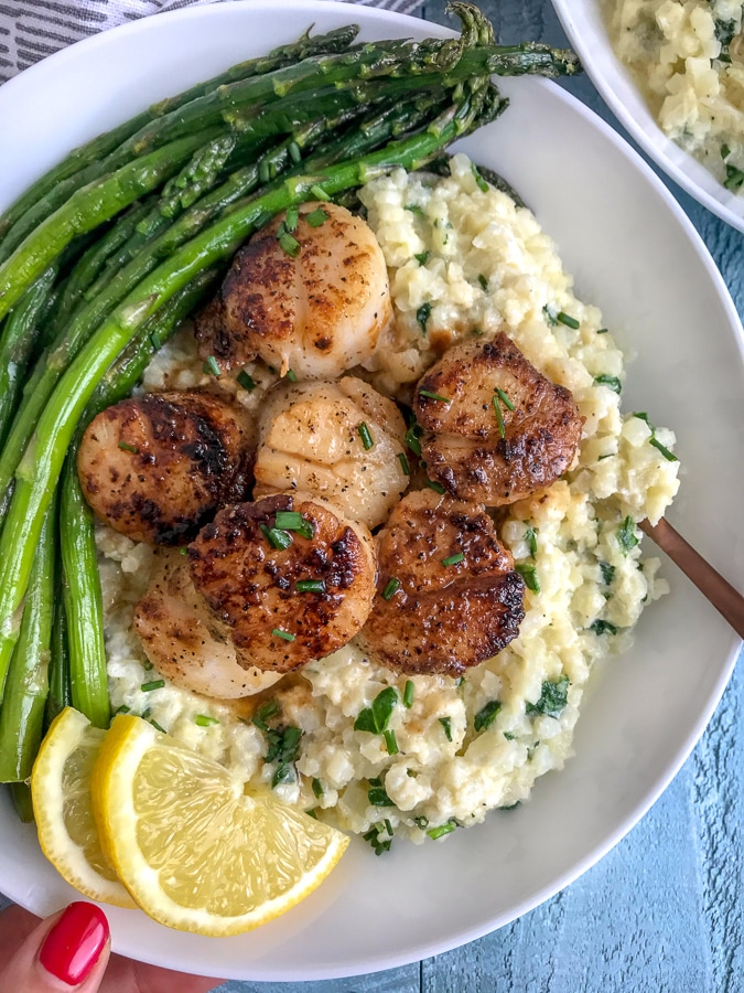 Learn how to make seared scallops like a professional chef! Easier than you think, cheaper than dining out, and pair well with Cauliflower Risotto! #searedscallops #cauliflower #risotto   https://withpeanutbutterontop.com