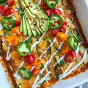"Creamy, shredded chicken stuffed into zucchini ""rolls"" and then baked in enchilada sauce and cheddar and monetary jack cheese. Very easy to make, low-carb, keto-friendly, and full of amazing flavors! #chickenenchiladas #lowcarb #keto #enchiladas 