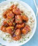 Sweet and spicy Firecracker Chicken served over cauliflower rice.