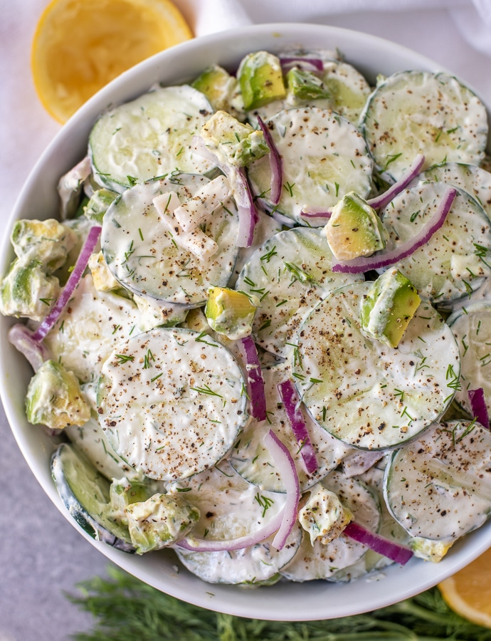 Bowl filled with Creamy Cucumber Avocado Salad.