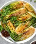 Bowl of sautéed baby bok choy brushed with homemade teriyaki sauce.
