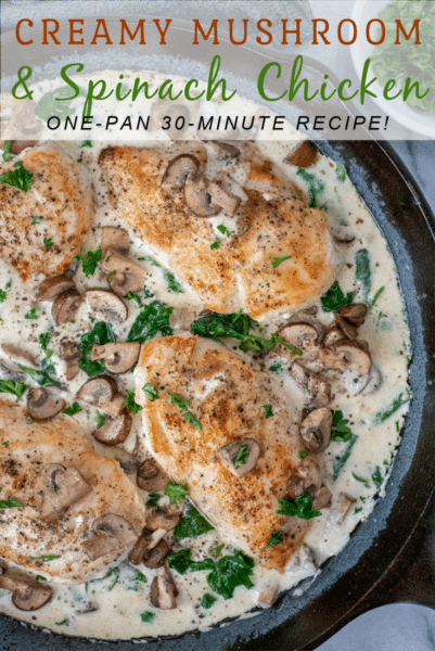 Cast iron skillet filled with a Creamy Mushroom and Spinach Chicken dish.