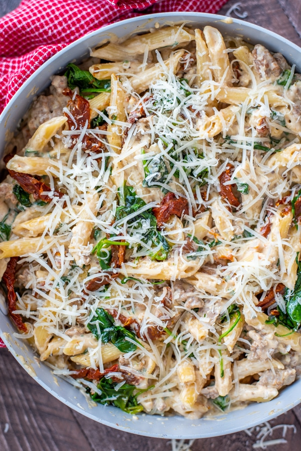 Pan filled with Creamy Spinach and Sun Dried Tomato Turkey Sausage Pasta.