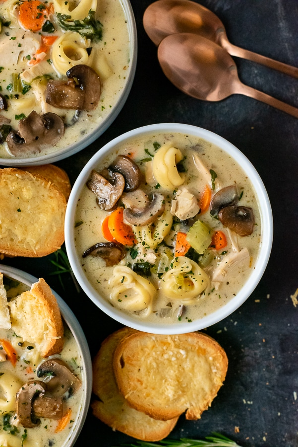 Bowls filled with Creamy Mushroom and Chicken Tortellini Soup. Served with toasted bread.